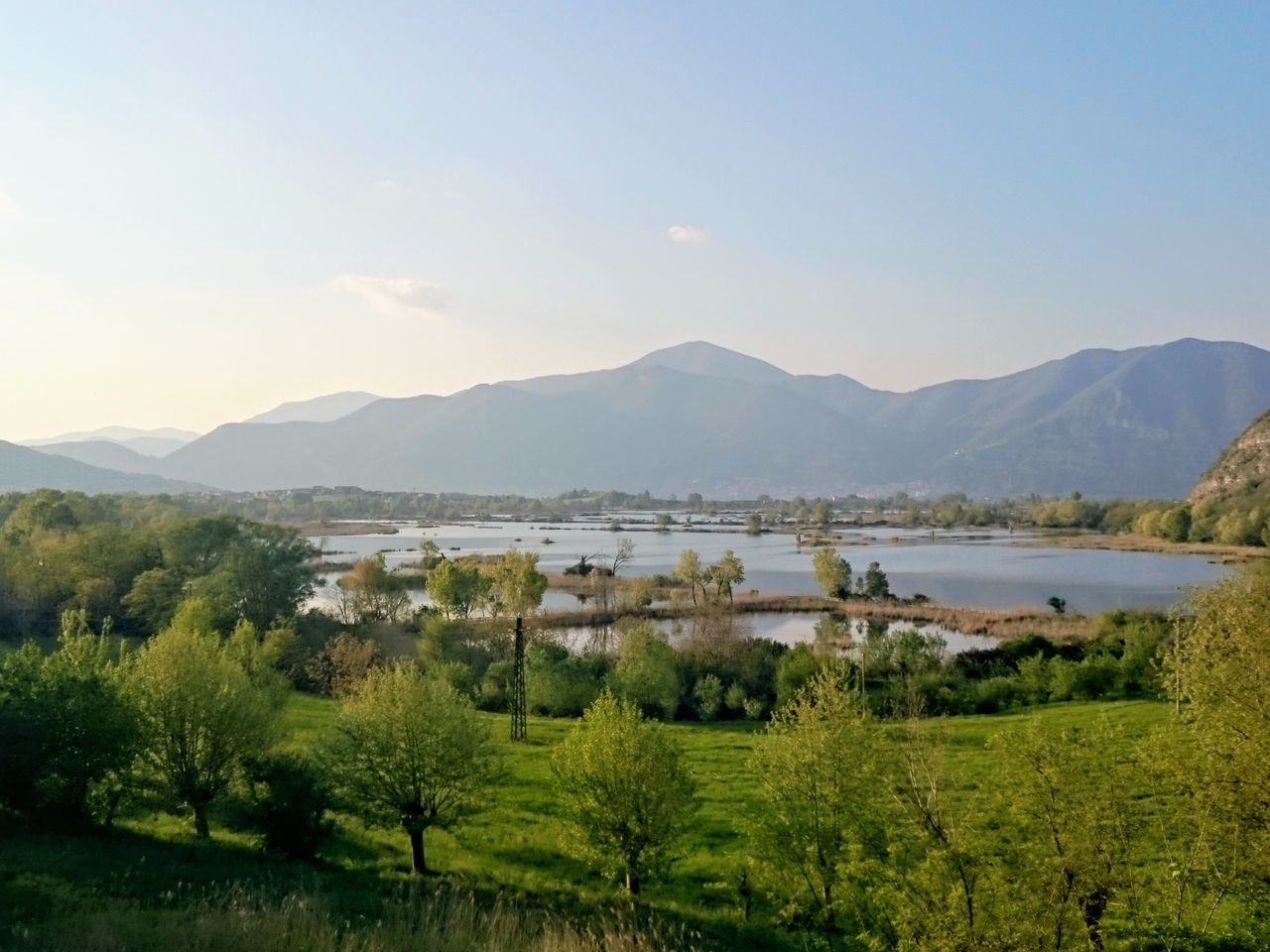Beauty In Nature Day Field Grass Iseo Iseo Lake Lake Lake Of Iseo Landscape Mountain Mountain Range Nature No People Outdoors Scenics Sky Torbiere Torbiere Del Sebino Tranquil Scene Tranquility Tree Water