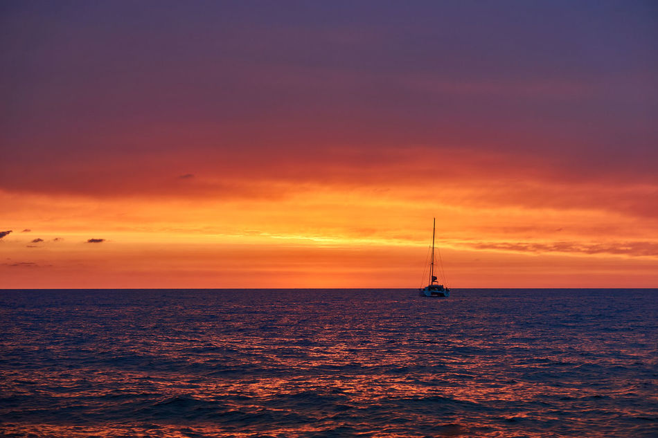 Sunset in front of Sailing Ship Beach Beauty In Nature Cloud - Sky Day Horizon Over Water Nature Nautical Vessel No People Outdoors Sailboat Sailing Sailing Ship Scenics Sea Silhouette Sky Sunset Tall Ship Tranquility Travel Destinations Water Yacht Yachting