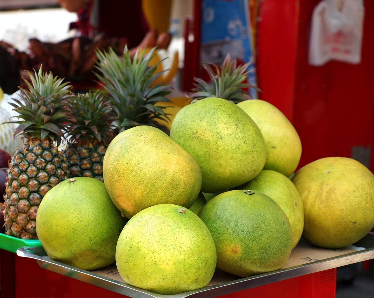 Pomelos for sale at the market. They are also called Chinese grapefruit or shaddock Citrus  Citrus Fruits Freshness Fruit Fruit Stand Grapefruit Healthy Eating Market Pineapples Pomelo Shaddock