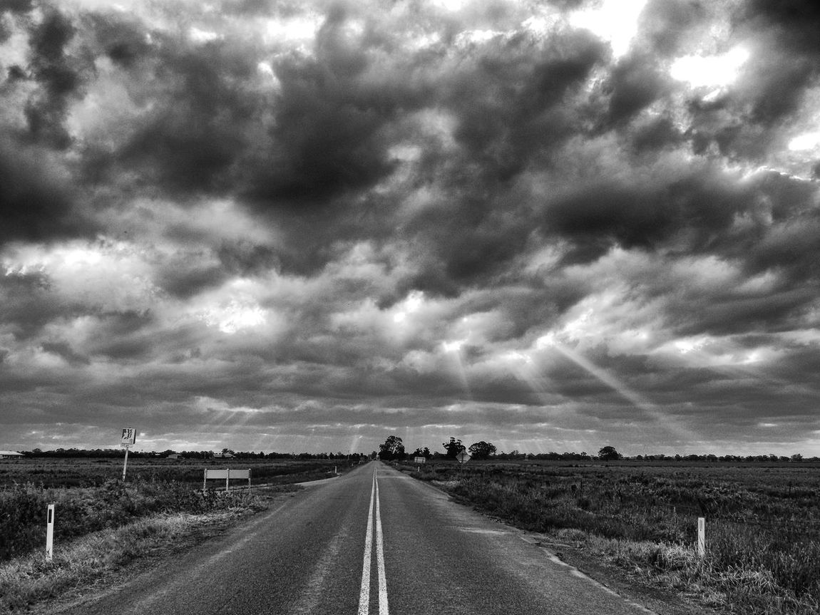 The Road to Enlightenment Cloud - Sky Cloudscape Cloudscape Cloudy Country Road Countryside Day Diminishing Perspective Empty Road Enlightenment Field Landscape Non-urban Scene Outdoors Road Road Scenics Sky Stormy Skies Straight Sunrays Through The Clouds The Way Forward Tranquil Scene Vanishing Point