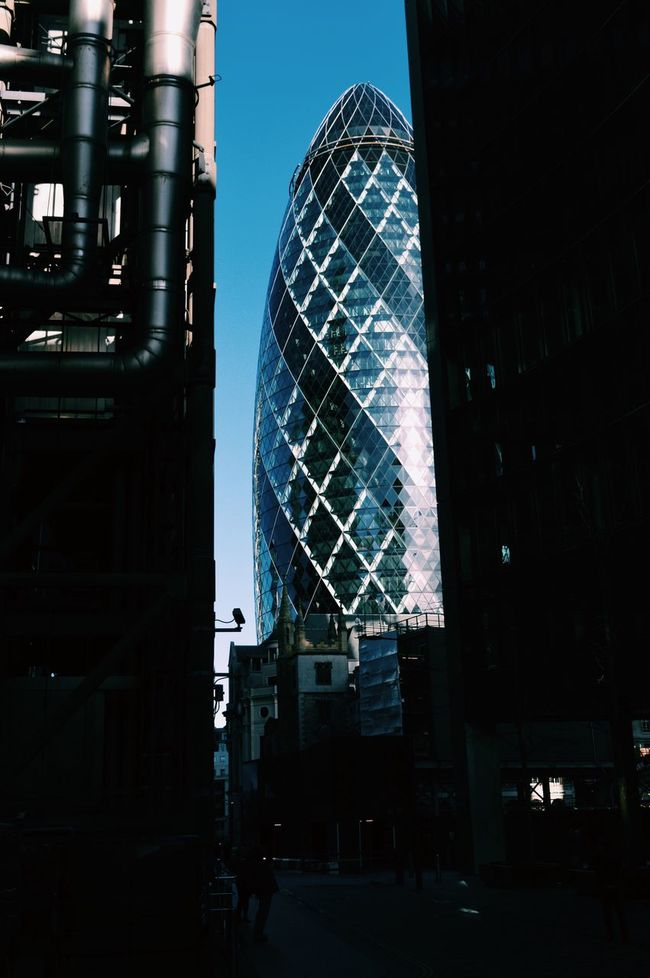 Architecture Built Structure Building Exterior Modern City Low Angle View Clear Sky Tower Tall Office Building Tall - High Skyscraper Sky Outdoors Blue Dark City Life Façade Development Building Story Gherkin Gherkin Tower The City City Of London