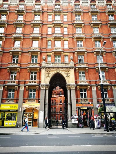 Building. Arch Architecture Building Exterior Built Structure Day Outdoors People Adult Adults Only One Person City One Man Only Only Men Pattern Multi Colored Cityscape London City Street City Life Arts Culture And Entertainment Travel Destinations King - Royal Person Palace