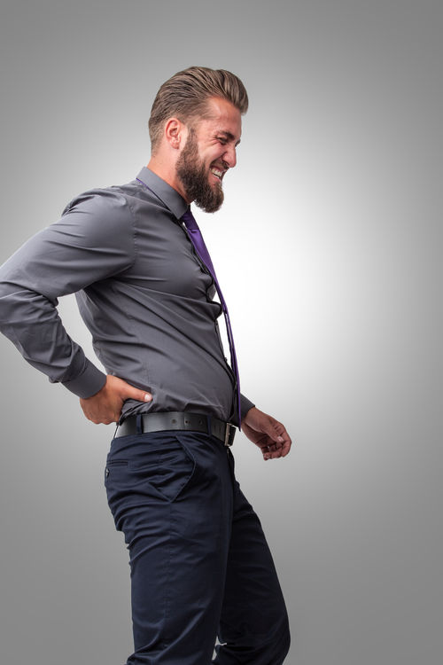 Businessman with back pain Ache Attractive Back Beard Businessman Concept Cramp Disease Full Length Gray Background Healthcare Human Ilness Isolated Lumbago Man One Pain People Person Sick Standing Studio Shot Therapy Touching