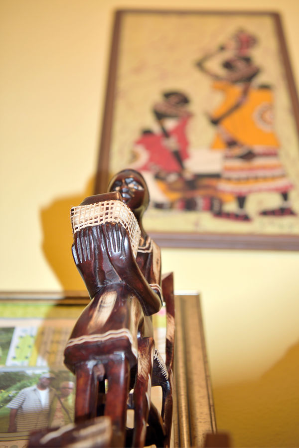 Mom's Figurines 3 African Art African Female Still Life Photography Still Life Collectibles Figurine  Wooden Statuettes Hand Carved Traditional Dress Holding Basket Seated Chair For Arts Sake Symbols Of Human Culture Abstract Photography Abstract Low Angle View Framed Painting Framed Collage Mom & Me Pictured Left-hand Corner