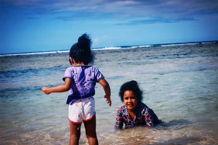 These 2 lil cutie 😍 Beachphotography VSCO Pastel Jayapura Papua Indonesia_photography Blue Sky And Sea Enjoying Life Photography View Showcasemarch Melanesian BaseG Beach Sisters Purple Curly Hair Don't Care Herebelongstome