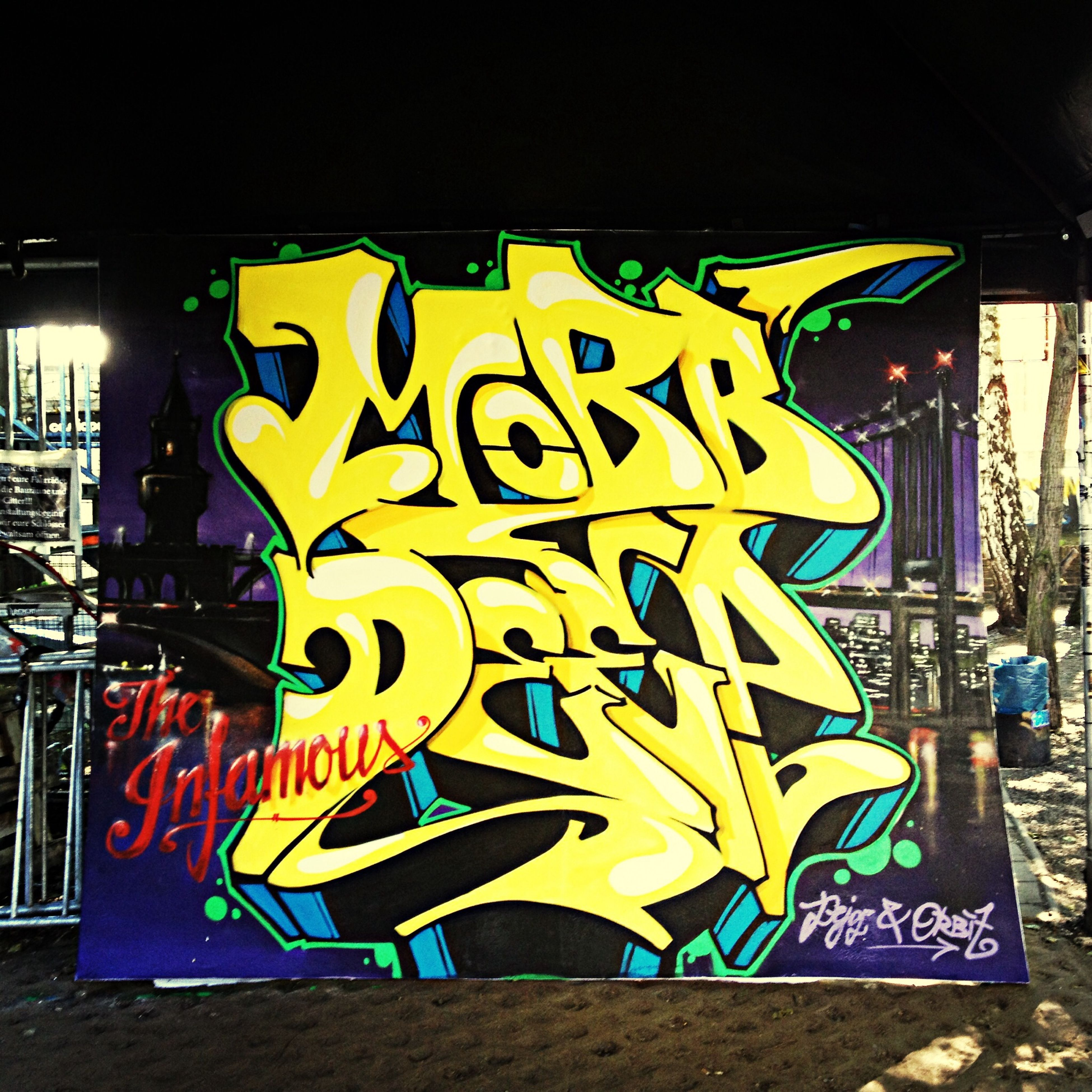 graffiti, art, text, creativity, art and craft, western script, multi colored, yellow, wall - building feature, communication, built structure, building exterior, architecture, human representation, street art, non-western script, outdoors, no people, sign, information sign