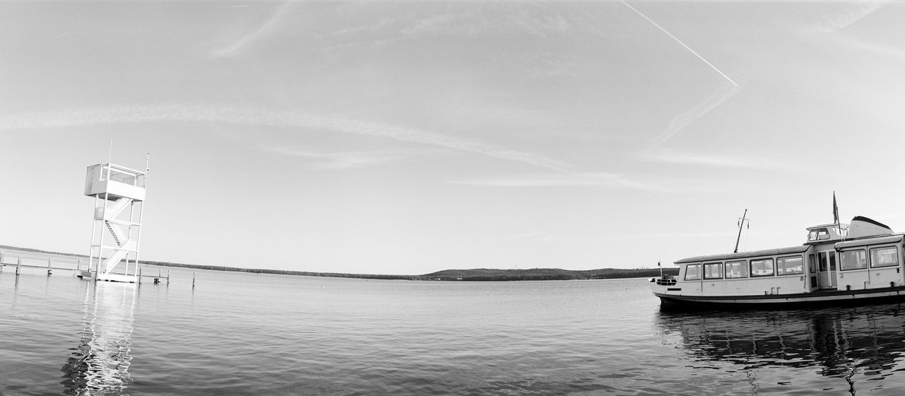Analogue Photography 120 Film Hp5 Black And White Monochrome Schwarzweiß Blackandwhite Film Photography Panoramic Photography Lake Beauty In Nature Boat Day Idyllic Mode Of Transport Nature Nautical Vessel No People Outdoors Sky Tranquil Scene Tranquility Water Waterfront Müggelsee
