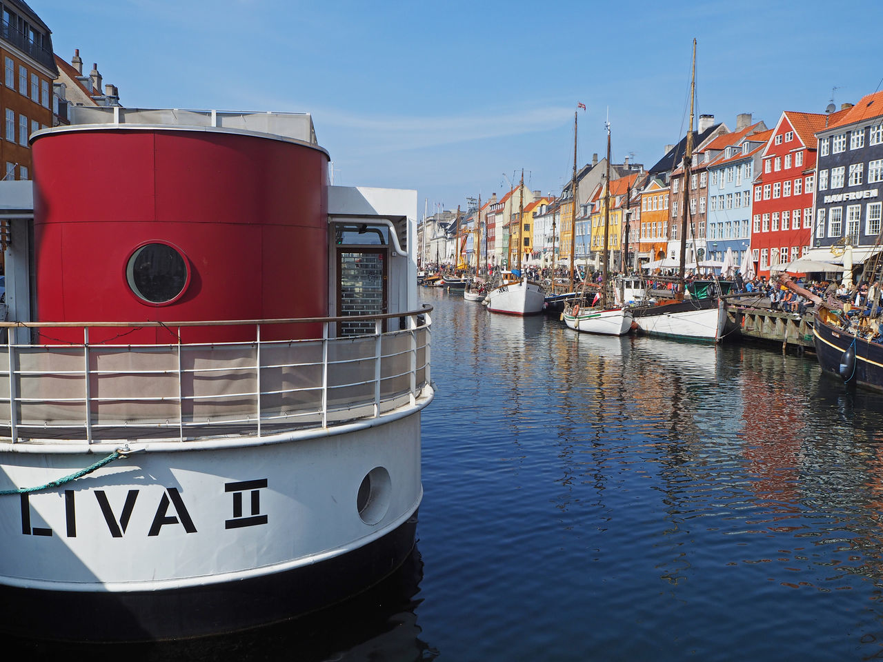 nautical vessel, mode of transport, transportation, architecture, building exterior, moored, built structure, no people, day, water, red, outdoors, sky, waterfront, nature, harbor