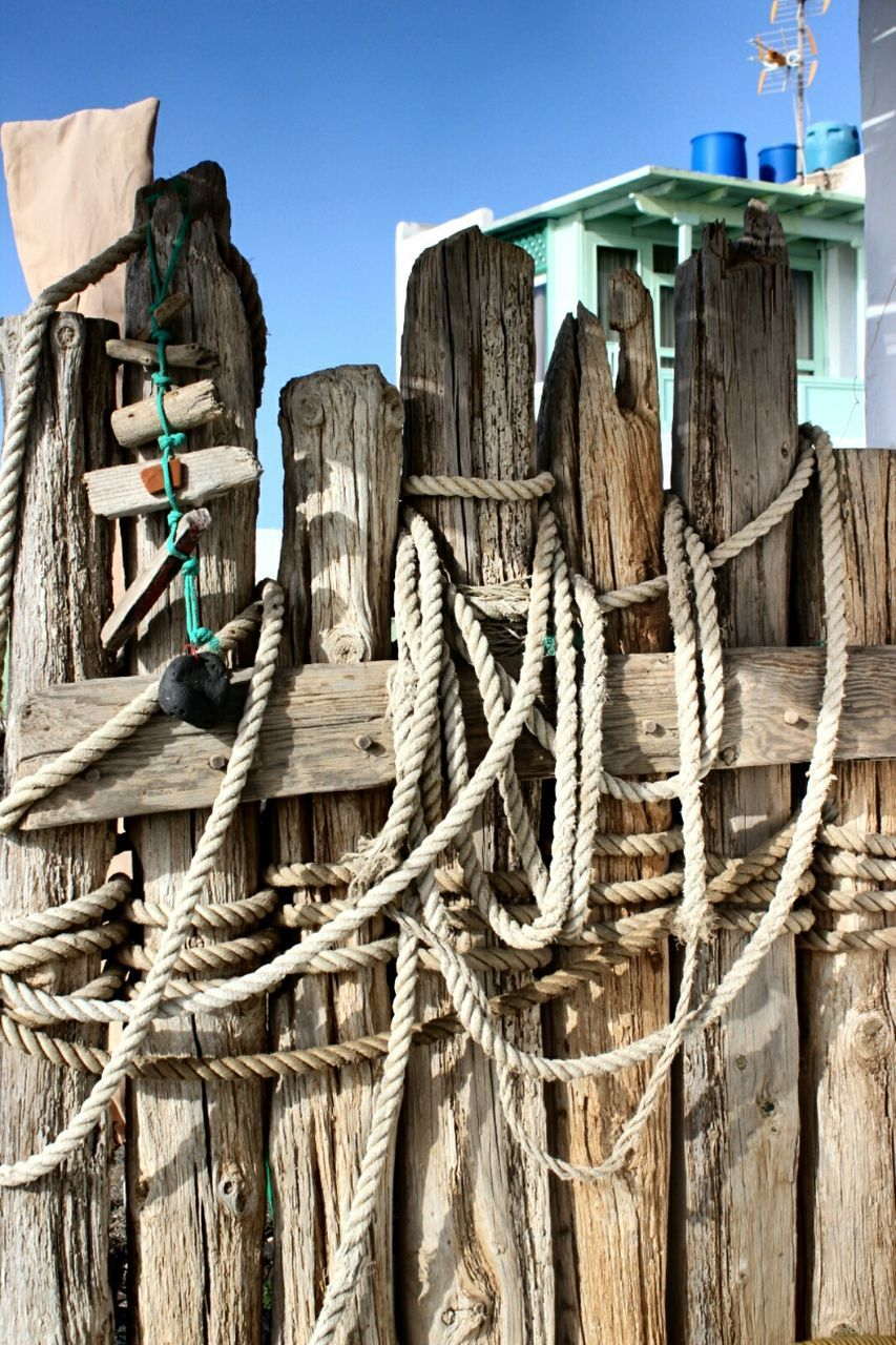 Tangled Rope On Wooden Fence
