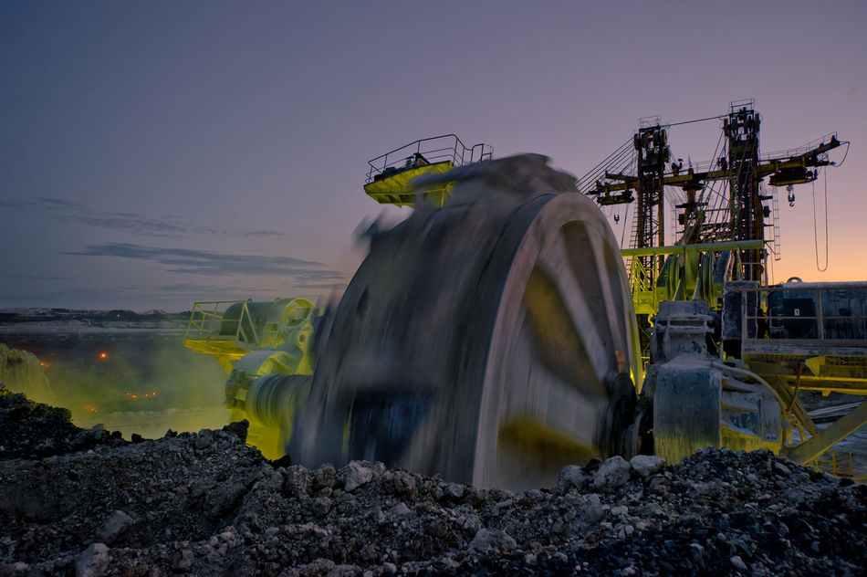 Russia, Stary Oskol, Stoilensky GOK, bucket wheel excavator, Stripping Bucket Wheel Excavator Commercial Dock Nature No People Outdoors Sky Stoilensky GOK Stripping The Land Sunset Tourism Travel Destinations Water