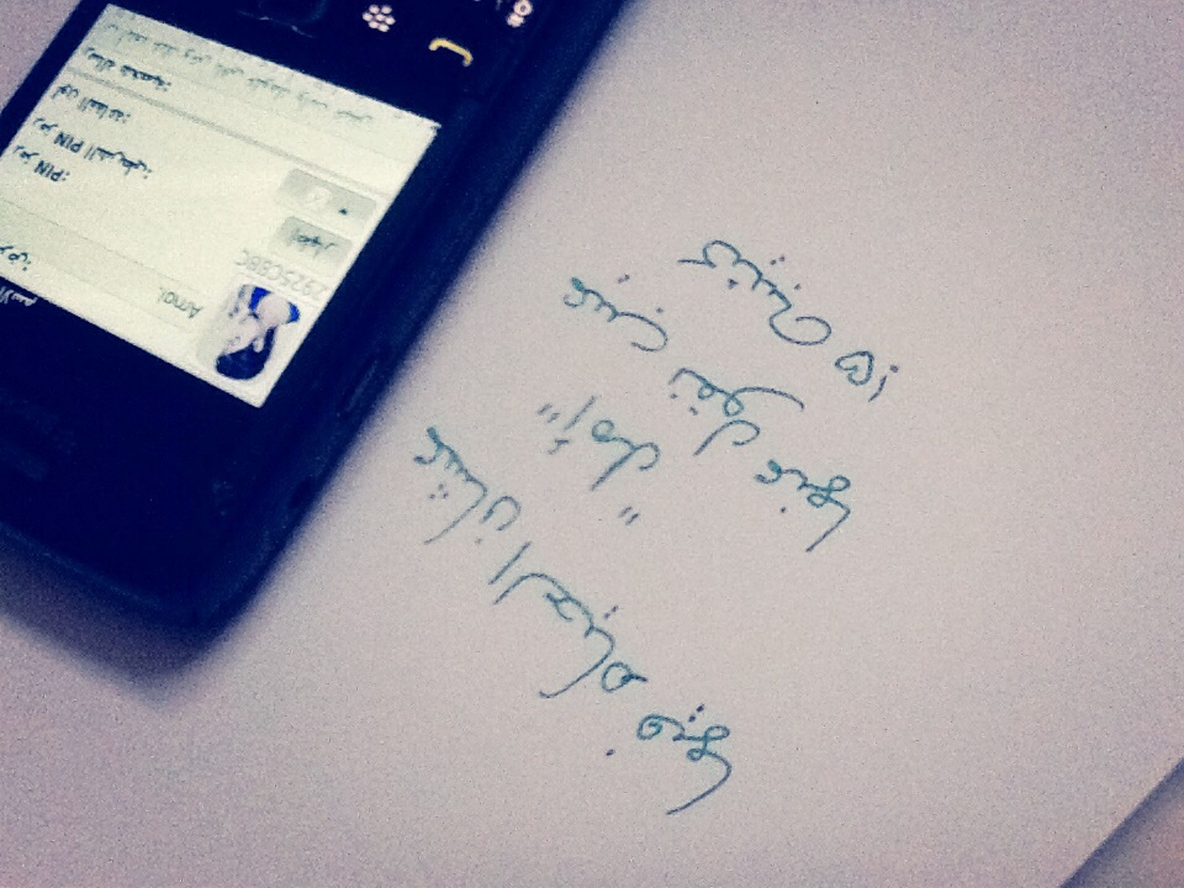 indoors, text, communication, western script, number, close-up, high angle view, technology, table, paper, handwriting, still life, message, no people, connection, non-western script, capital letter, computer keyboard, book, writing