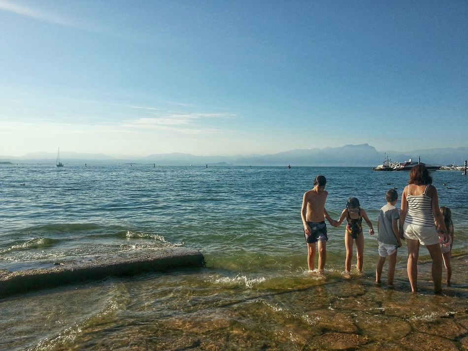 Sea Beach Horizon Over Water Water Sky Vacations People Outdoors Leisure Activity Nature Togetherness Day Beauty In Nature Scenics Lago Di Garda, Italy Garda Lake Italy