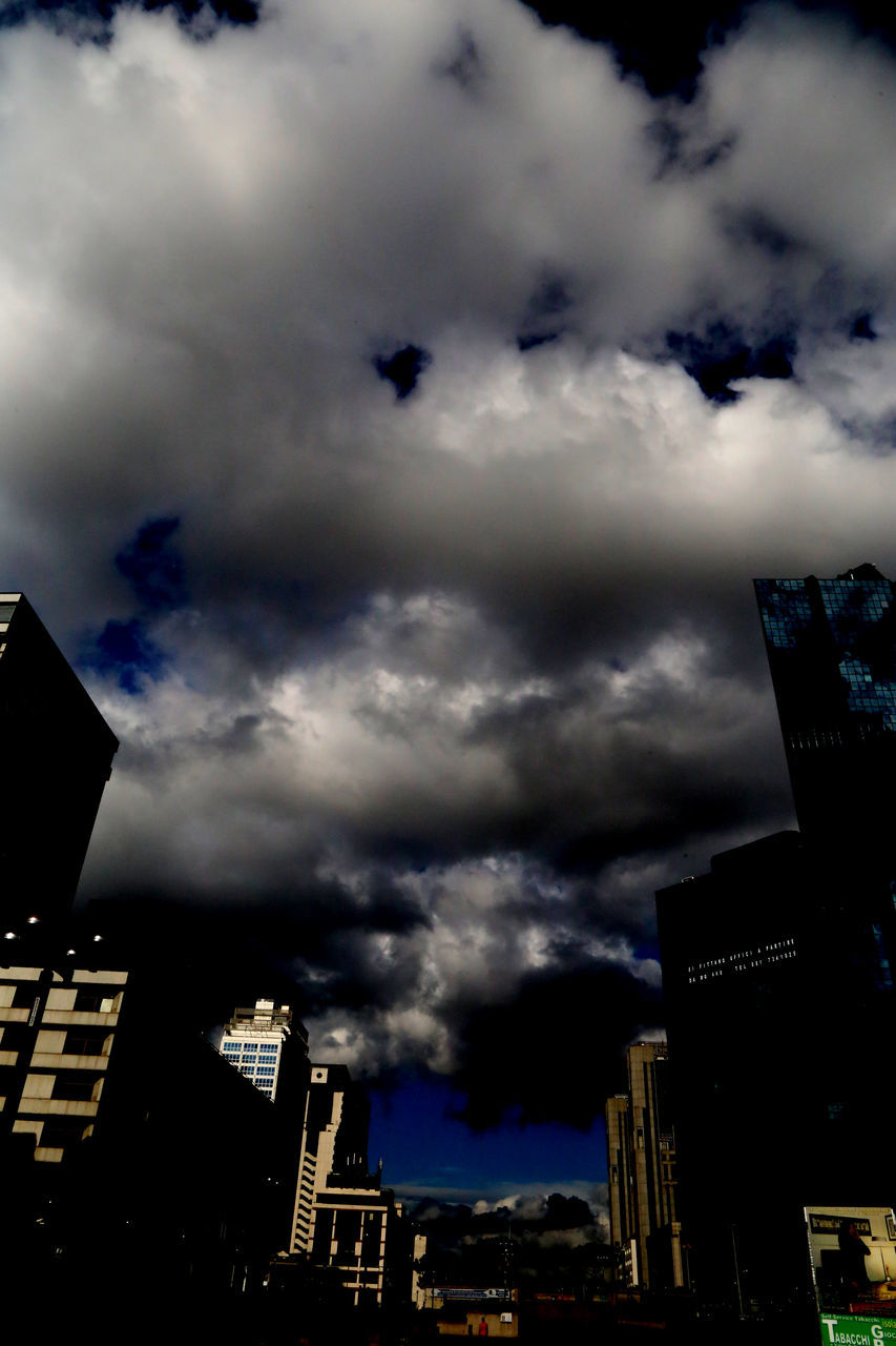 cloud - sky, architecture, building exterior, sky, built structure, city, skyscraper, modern, low angle view, no people, outdoors, cityscape, storm cloud, day, nature