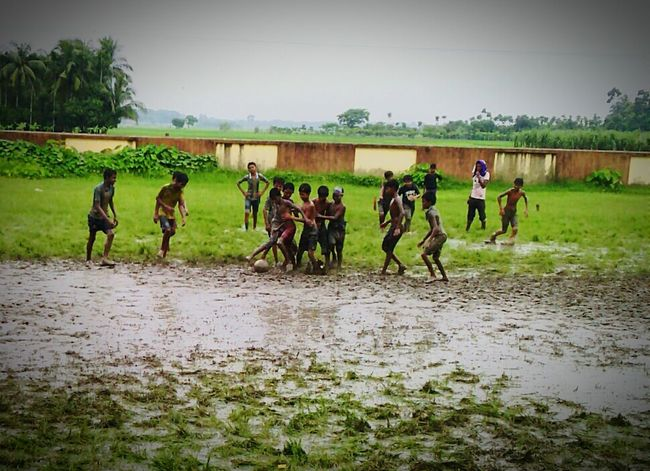 FOOTBALL N MUD Taking Photos