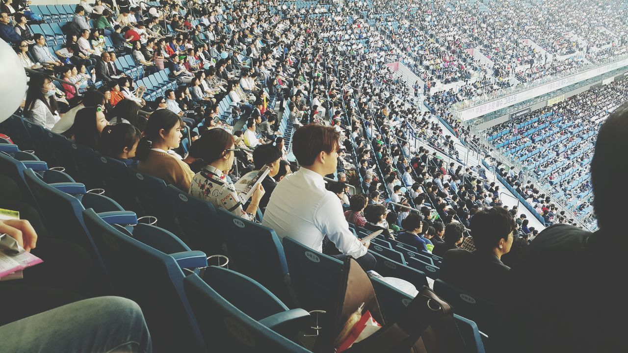 crowd, large group of people, stadium, audience, spectator, togetherness, sport, real people, watching, men, fan - enthusiast, night, women, indoors, people, adult, adults only