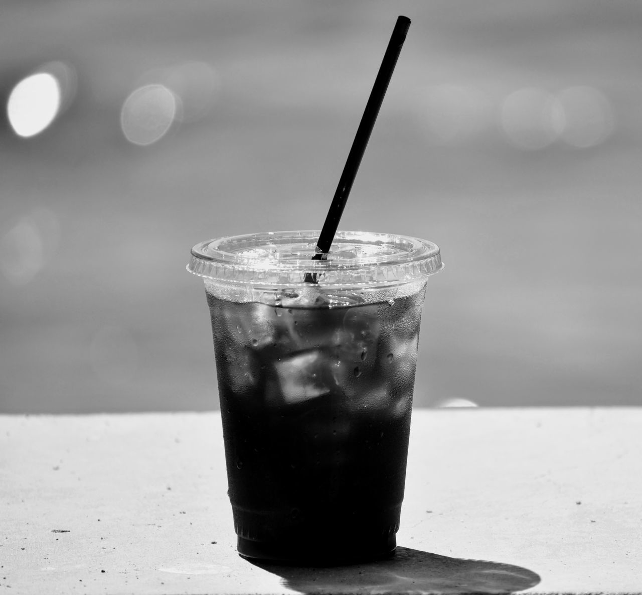 Ice coffee Drinking Straw Drink Drinking Glass Cola Refreshment Food And Drink Ice Cube No People Table Cold Temperature Indoors  Freshness Tonic Water Day Close-up