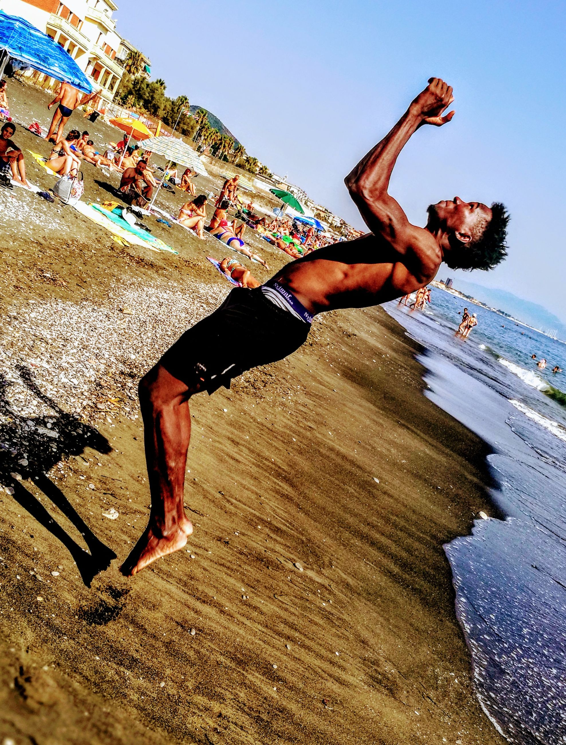shirtless, real people, men, day, leisure activity, fun, lifestyles, outdoors, full length, beach, one person, sky, young adult, nature, people