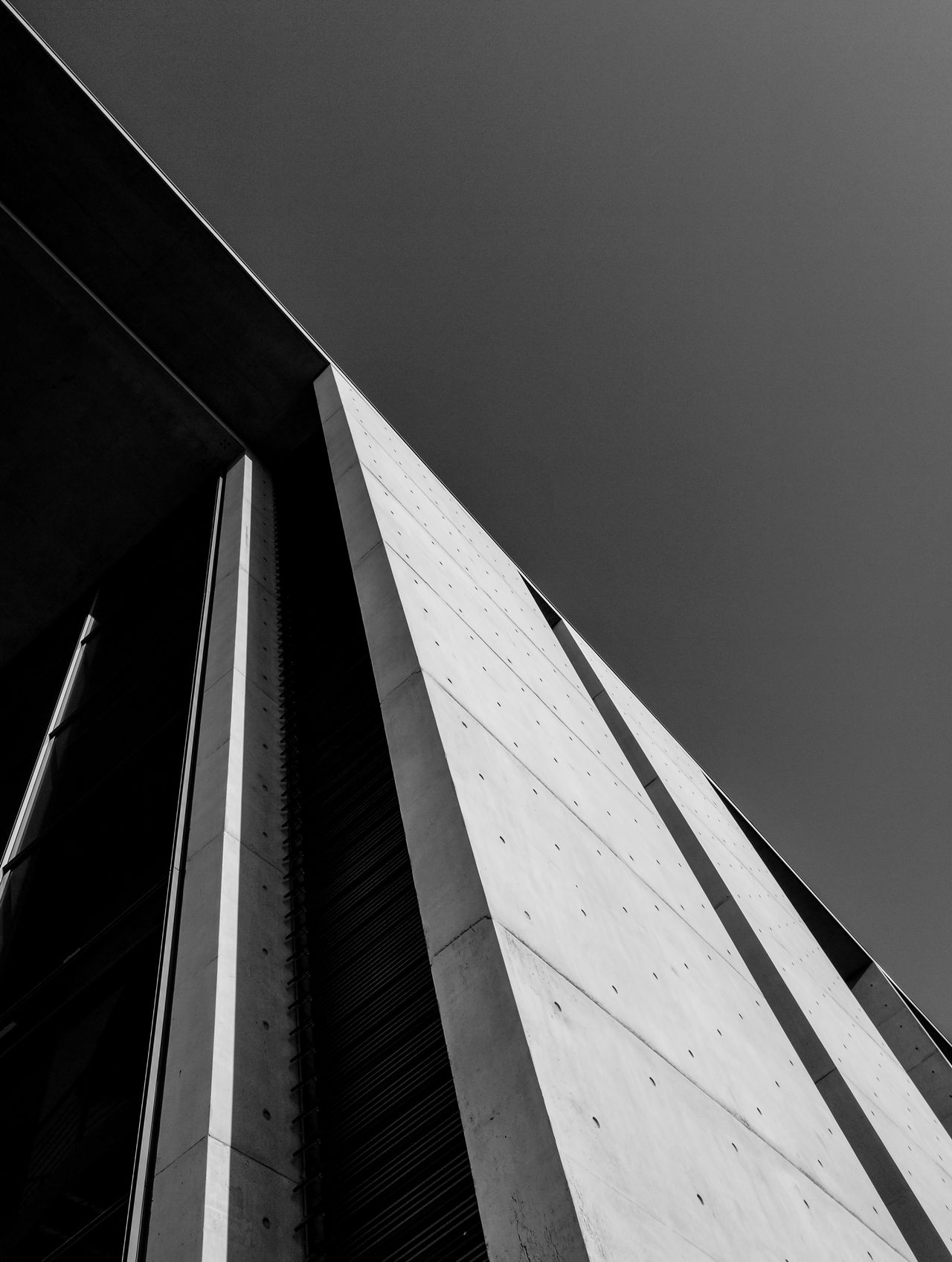Blackandwhitearchitecture Architectural Detail Architecture Architecture_bw Architecture_collection Berlin Berlin Black & White Berlin Monochrome Berlin Photography Berlin Schwarzweiss Berliner Ansichten Black And White Berlin Blackandwhite Photography Building Exterior Built Structure Huawei Monochrome HuaweiP9 Lookingup Architecture Low Angle View Minimalism Minimalist Architecture Modern Monochrome Berlin No People Schwarzweiß