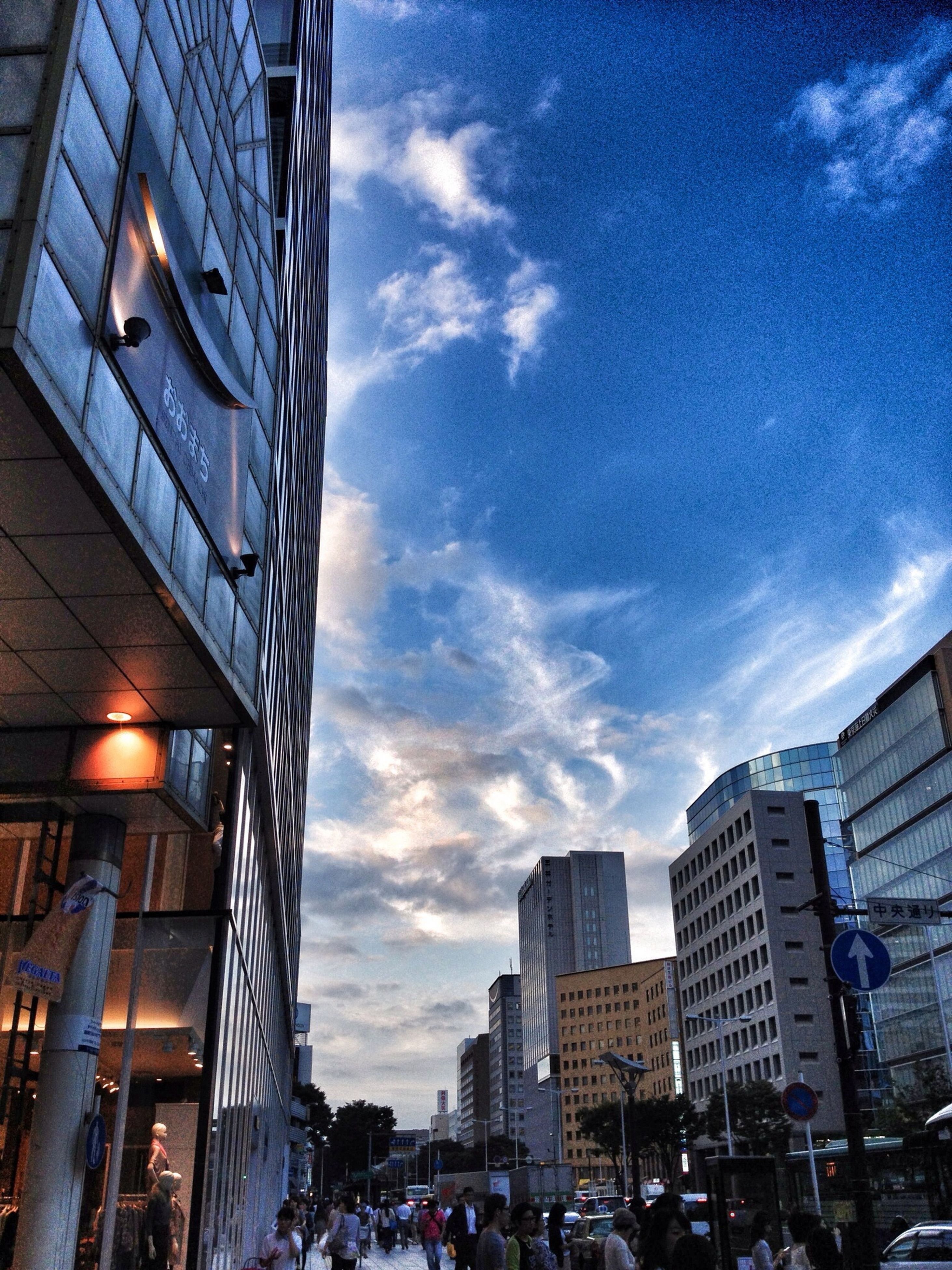 building exterior, architecture, built structure, city, sky, low angle view, building, modern, office building, city life, cloud - sky, street, residential building, skyscraper, residential structure, cloud, outdoors, day, city street, cityscape