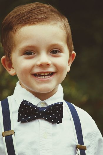 EyeEm Selects Portrait Child Looking At Camera Smiling Childhood Children Only One Person Bow Tie Headshot Front View People Happiness Pride Boys Cheerful One Boy Only Standing Outdoors Close-up Day