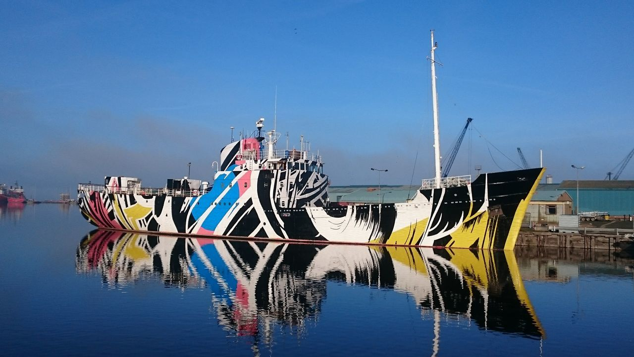 The Dazzle Ship, Edinburgh. Reflection Nautical Vessel Transportation Water Outdoors Reflection Hanging Out Ship Ship Details Ships ShipSpotting Camouflage Dazzleships Dazzle Ships Dazzle Ship EyeEm Best Shots Edinburgh Leith Docks