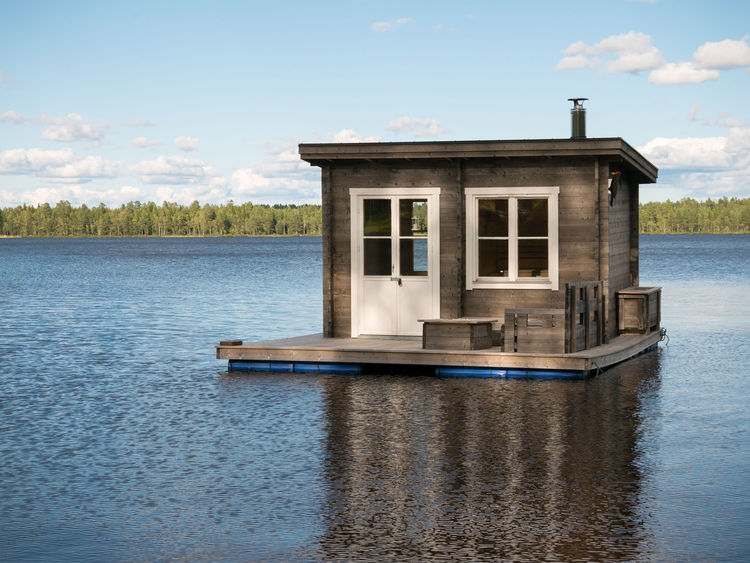 A floating sauna Cloud Cloud - Sky Day Floating House Floating Sauna House Idyllic Nature No People Outdoors Sauna Sky Tranquil Scene Tranquility Water