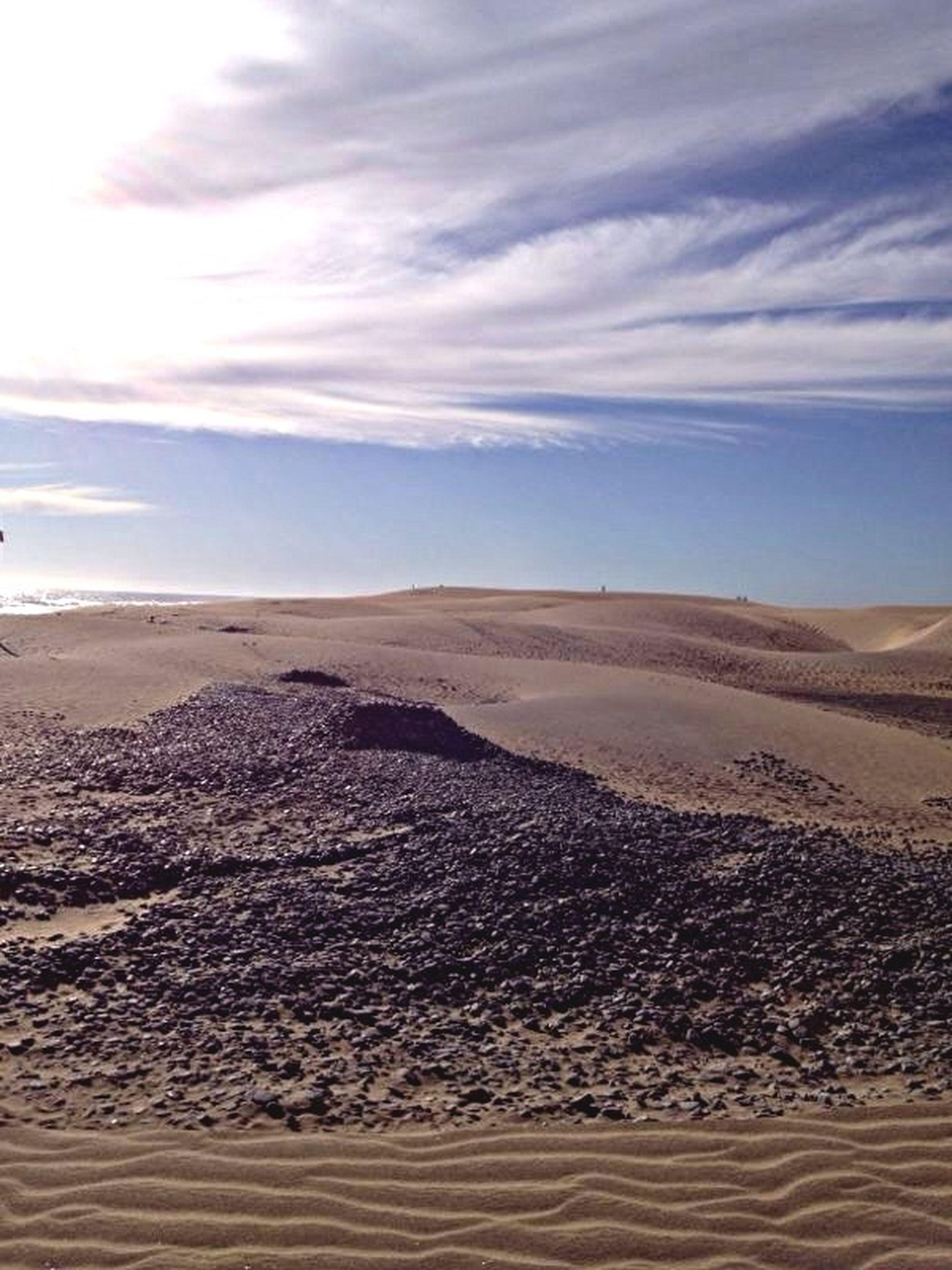 sand, beach, tranquil scene, tranquility, scenics, sky, sea, beauty in nature, sand dune, shore, desert, nature, footprint, horizon over water, idyllic, remote, landscape, water, arid climate, non-urban scene