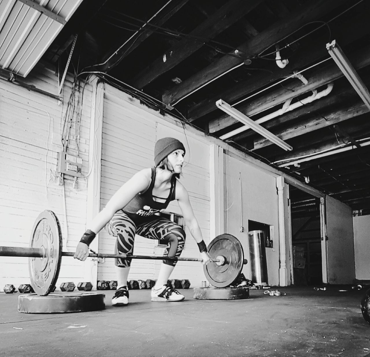 Adults Only Young Adult Adult Young Women Indoors  People Weightlifting One Person Weightlifter Snatches one person Only Men Sports Venue Day Headwear Desaturated