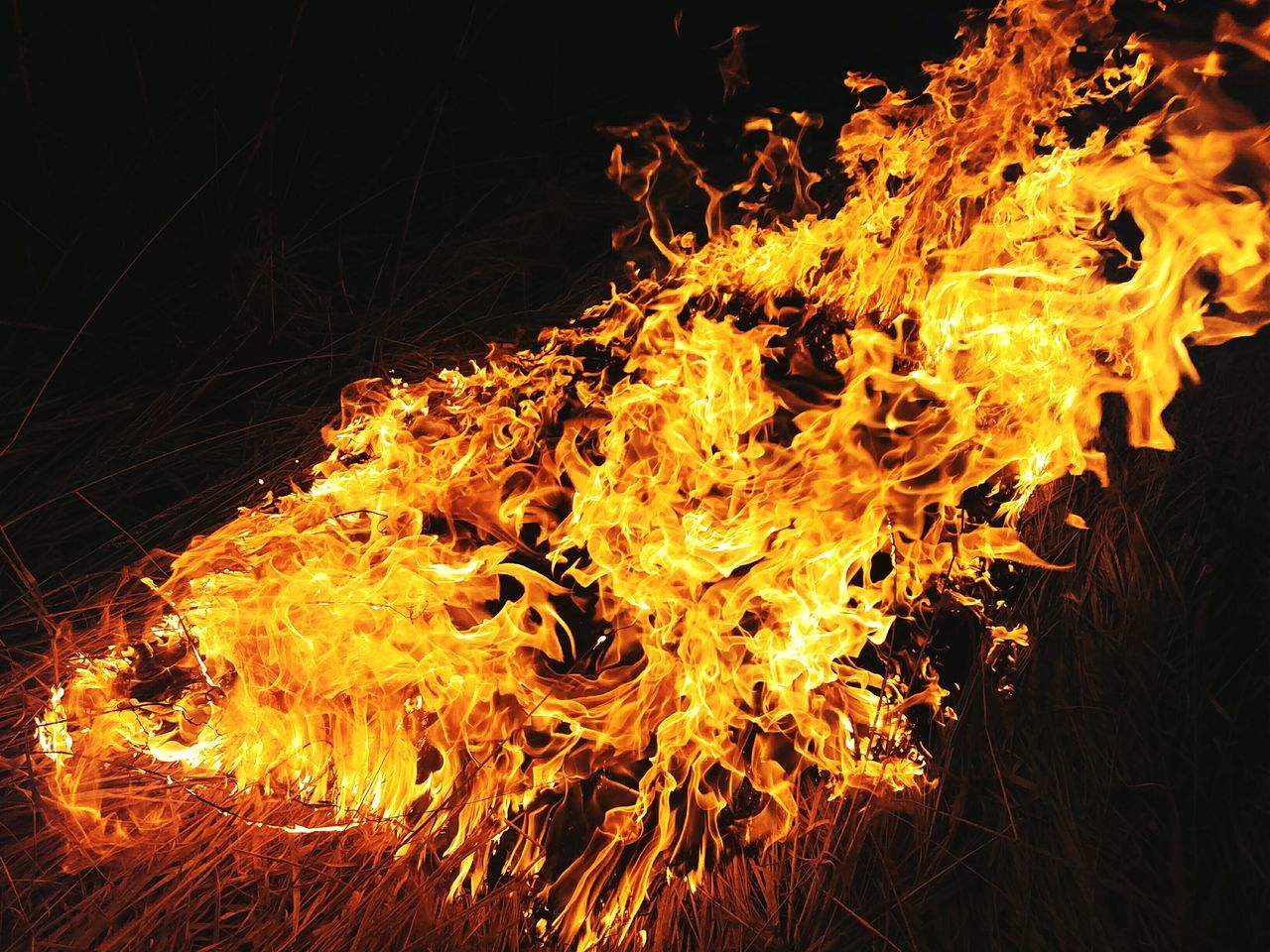 Heat - Temperature Flame Orange Color Burning Close-up Black Background Night No People Outdoors Exploding Molten Metal Industry Golf Club