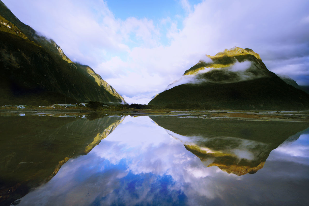 reflection, water, sky, beauty in nature, lake, symmetry, nature, waterfront, tranquil scene, tranquility, standing water, idyllic, scenics, outdoors, cloud - sky, refection, no people, day, tree, mountain