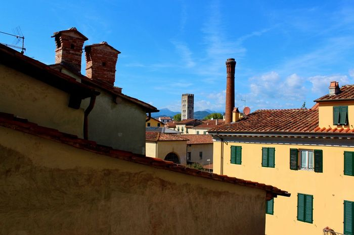 Lucca, Italy Chimney Lucca Palazzo Micheletti Quaint  San Pietro Somaldi Wooden Shutters Architecture Backgrounds Blue Building Exterior Built Structure Clouds And Sky Day Drainage Italy Low Angle View Nature No People Outdoors Roof Sky Tiled Roof  Tower Village Yellow The Week On EyeEm Your Ticket To Europe