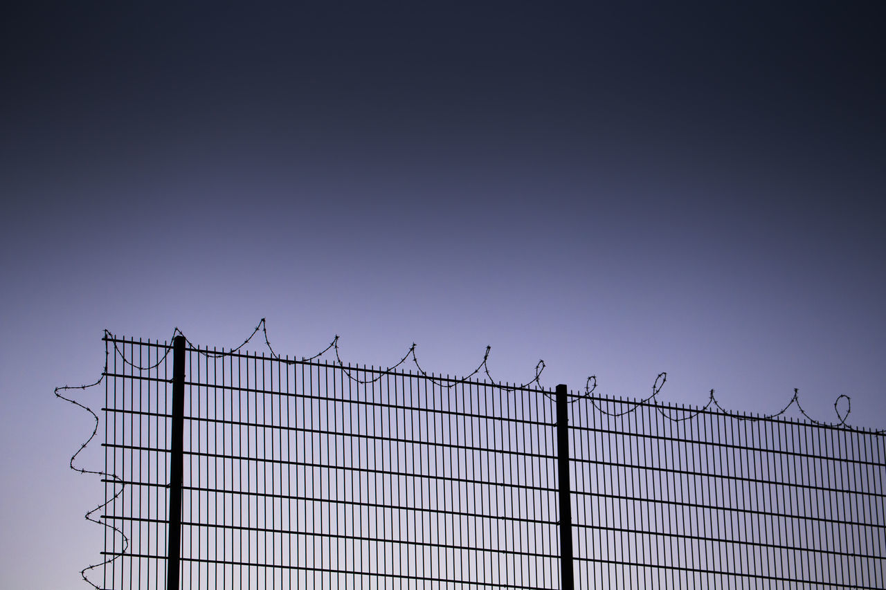 Barbed Wire Behind Captured Clear Sky Copy Space Day Excluded Exclusion Fence Freedom Goal No People Outdoors Prison Protection Security System Separation Sky Target