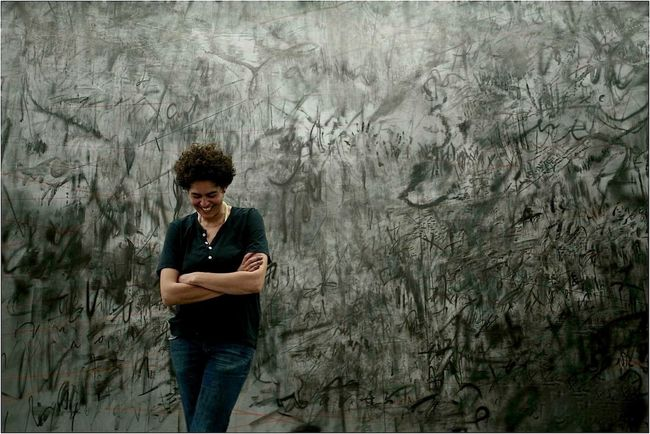 painter Julie Mehretu /NYC Artist Artstar Carefree Celebrity Portraiture Front View Full Length Painter Painting San Francisco Museum Of Modern Art Standing Wall Women