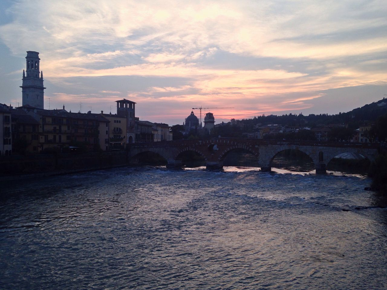 165/365 June 14  One Year Project 2017 Verona Italy Bridge - Man Made Structure Adige River Veneto Italy Ponte Pietra Verona Sunset Architecture Water Built Structure River Sky Cloud - Sky Waterfront Building Exterior Connection Rippled Nature No People Outdoors City Day