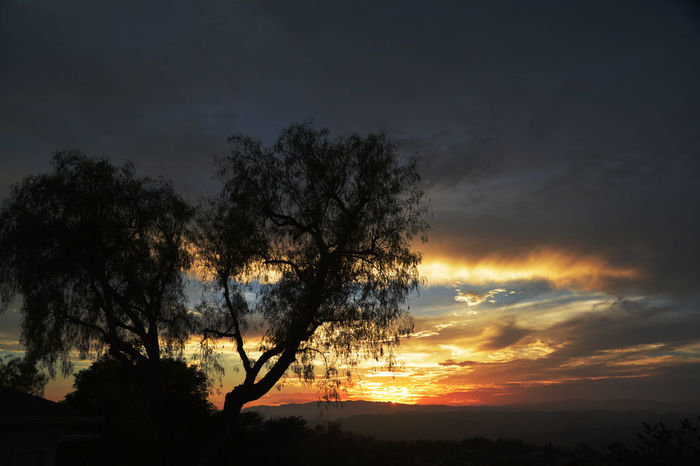 August 1 sunset with lingering clouds after a rainy afternoon. Fallbrook A Clouds Post Rain Sunset