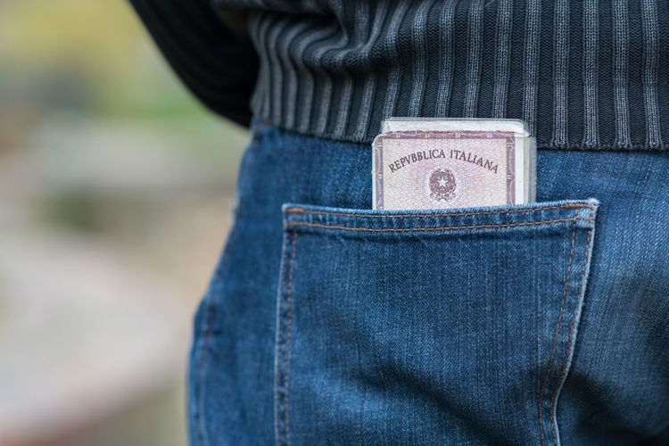 Italian identity card in the back pocket of a jeans Frontier Holiday Holidays Immigration Passport Travel Traveling Vacations Casual Clothing Checkpoint Close-up Control Denim Emigrants Emigration Id Identification Identity Cards Immigrant Jeans Outdoors Personal Documents Pocket  Tourism Vacation