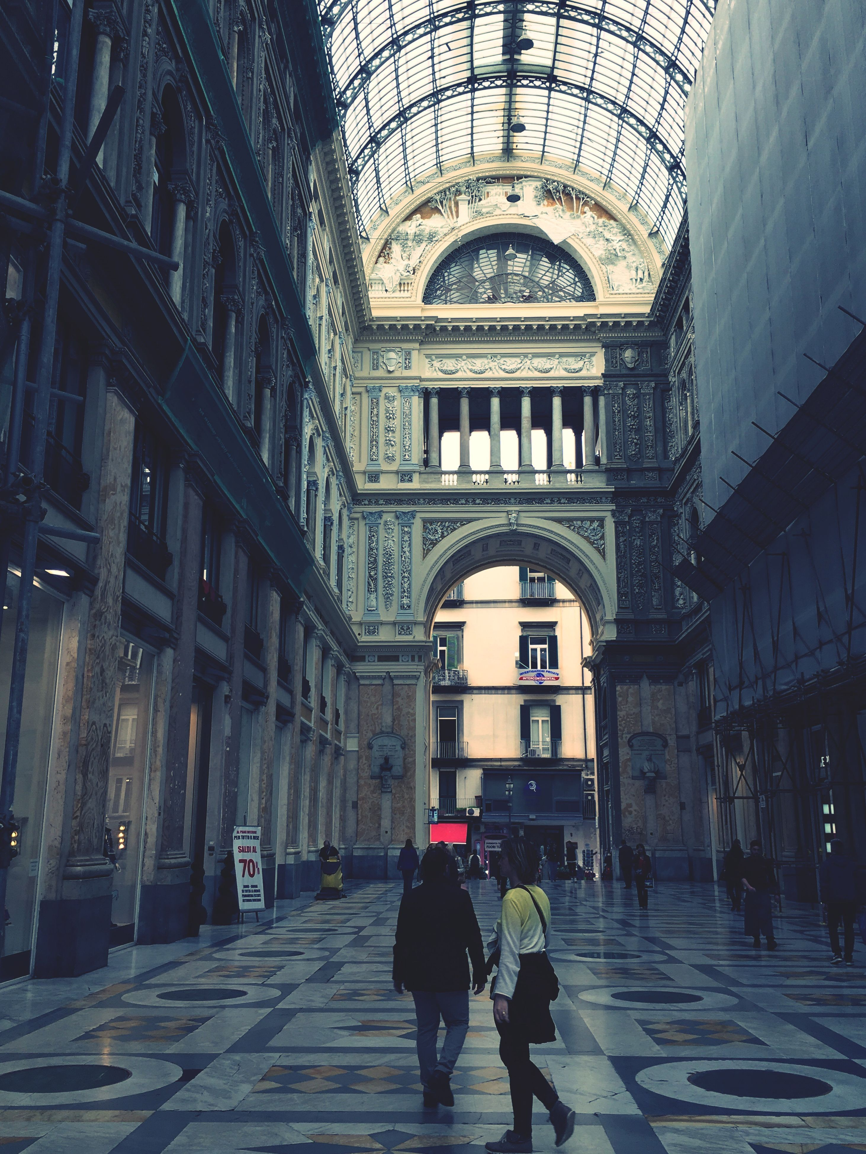 architecture, built structure, walking, men, lifestyles, full length, indoors, building exterior, person, the way forward, rear view, arch, leisure activity, building, city life, city, corridor