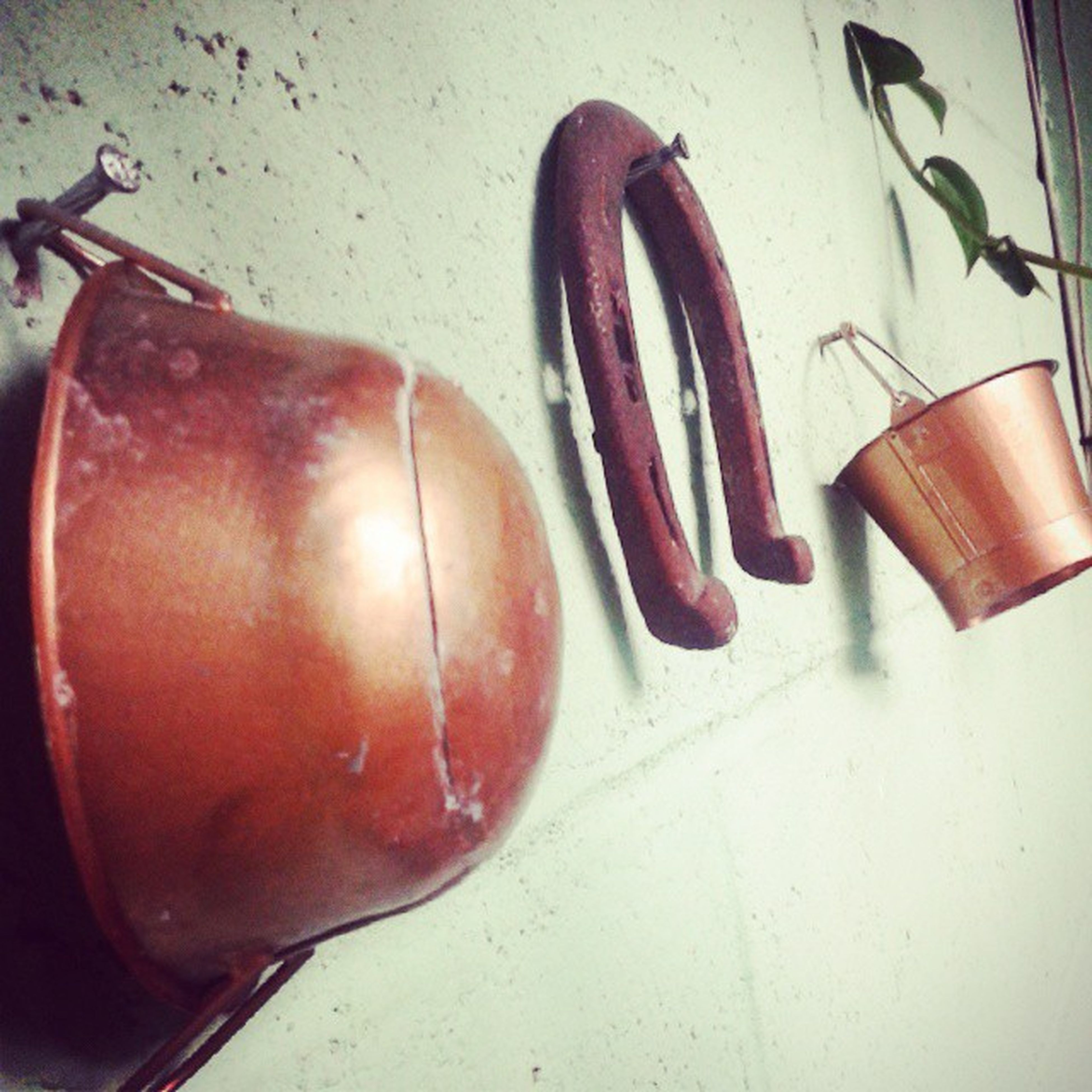 indoors, still life, red, table, close-up, high angle view, wall - building feature, no people, food and drink, metal, shadow, wall, day, wood - material, potted plant, single object, home interior, old, container, sunlight