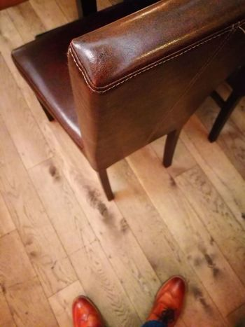 Hardwood Floor Human Foot Low Section Wood - Material Indoors  Shoe Human Leg Human Body Part Home Interior Red High Angle View Brown Chair Lifestyles People One Person Adult Day Close-up