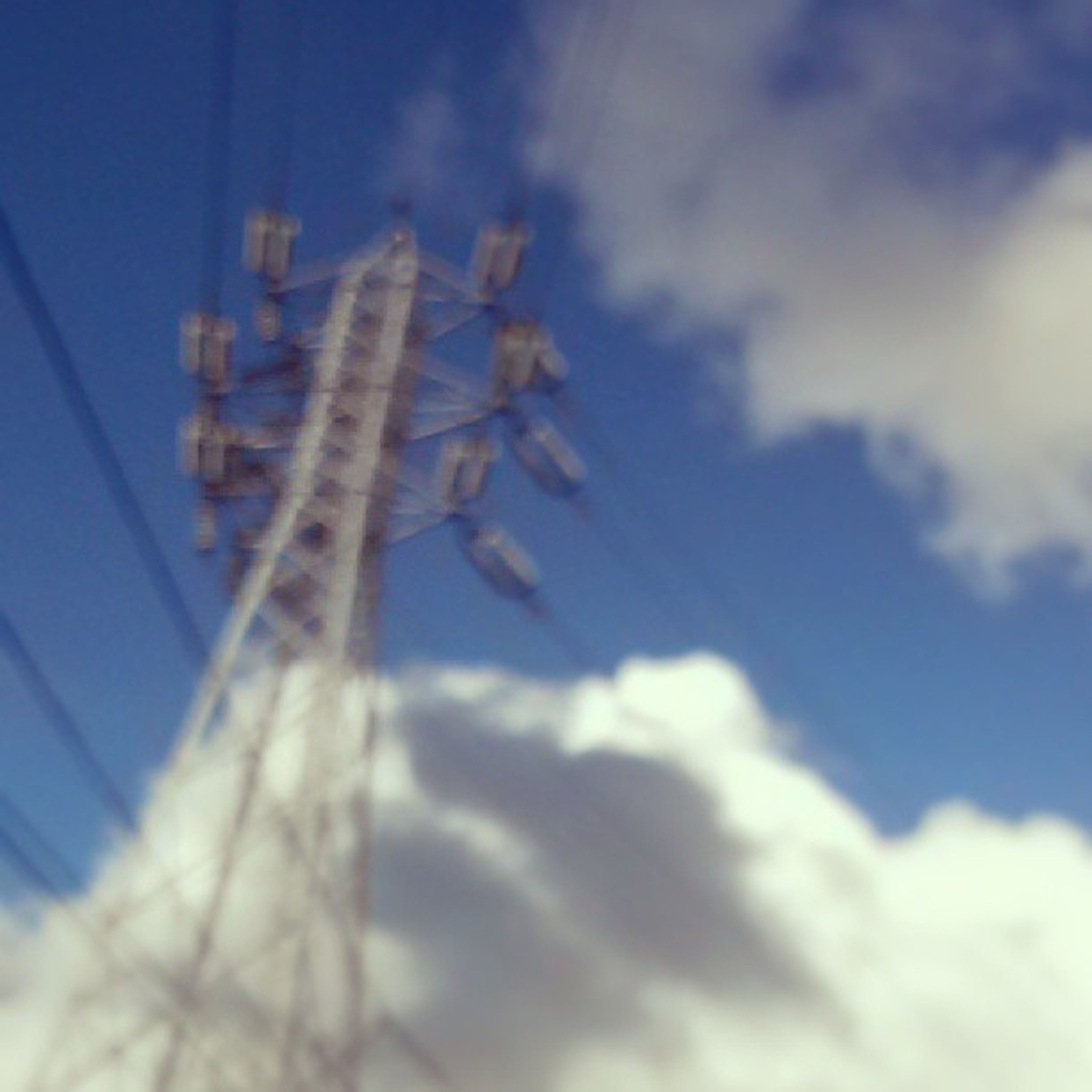 low angle view, sky, blue, cloud - sky, nature, cloud, outdoors, day, no people, built structure, beauty in nature, cloudy, sunlight, growth, close-up, power line, dusk, tranquility, white color, architecture