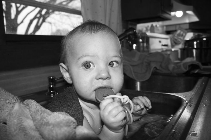 Sink Bath Baby Bath Time Big Eyes Blackandwhite Boys Childhood Cute Day EyeEm Gallery EyeEmNewHere Indoors  Kitchen Looking At Camera Low Angle View One Person People Portrait Real People Sink Bath Wide Angle