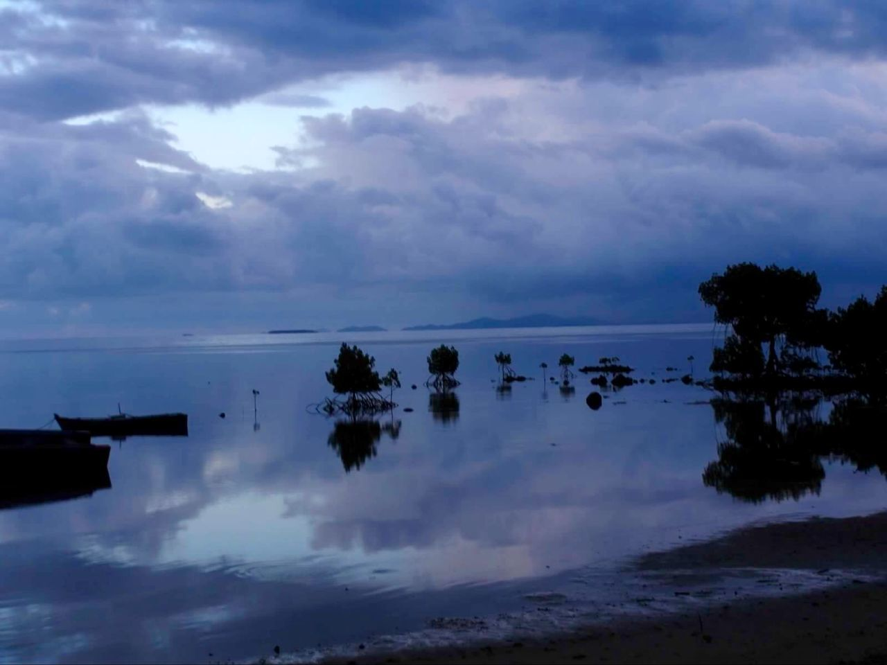 cloud - sky, sky, tranquility, tranquil scene, reflection, no people, nature, water, beauty in nature, scenics, outdoors, silhouette, tree, day, horizon over water