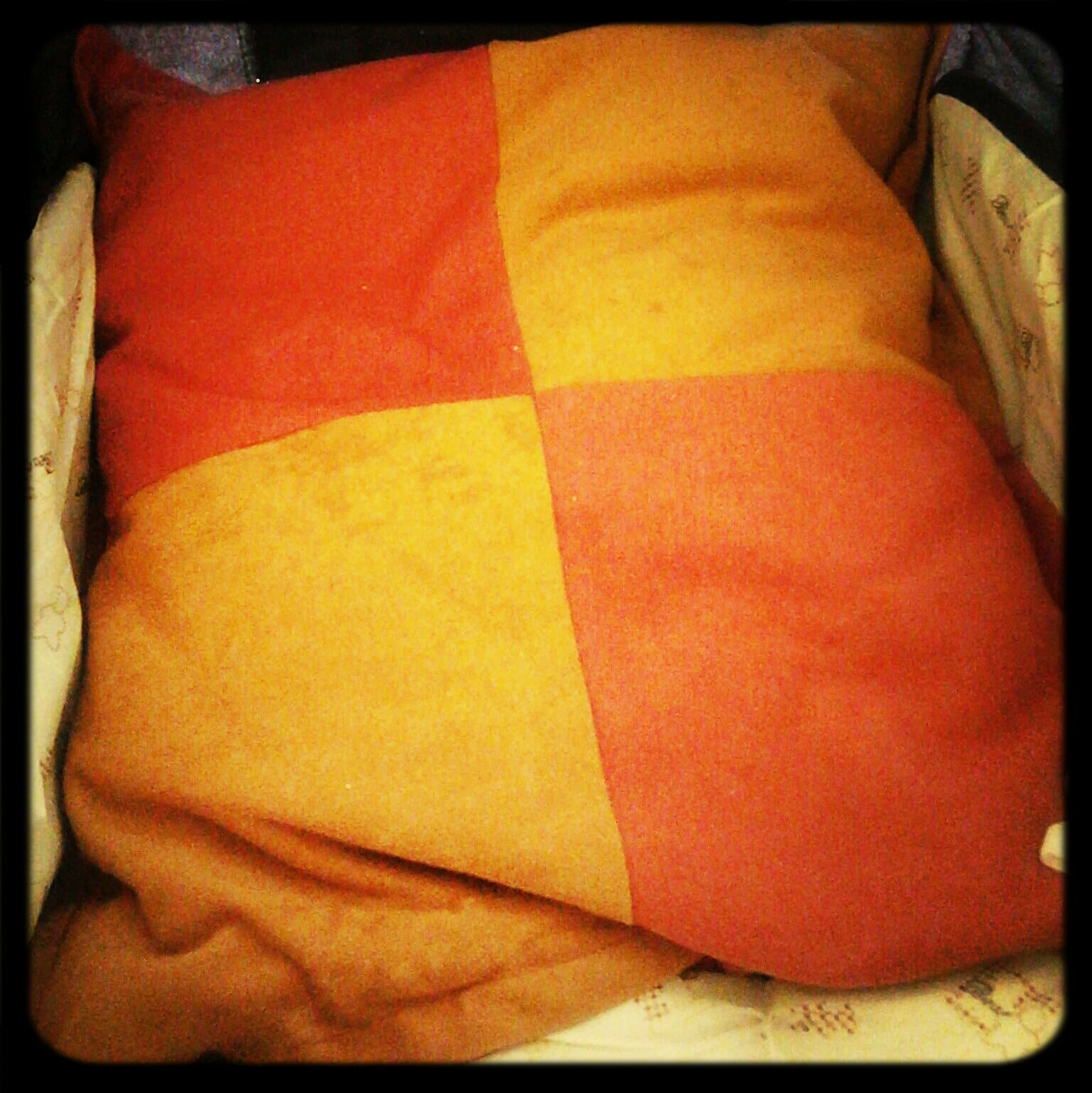 transfer print, indoors, auto post production filter, close-up, red, high angle view, bed, textile, relaxation, no people, orange color, fabric, full frame, blanket, day, stack, sofa, backgrounds, pattern, sunlight