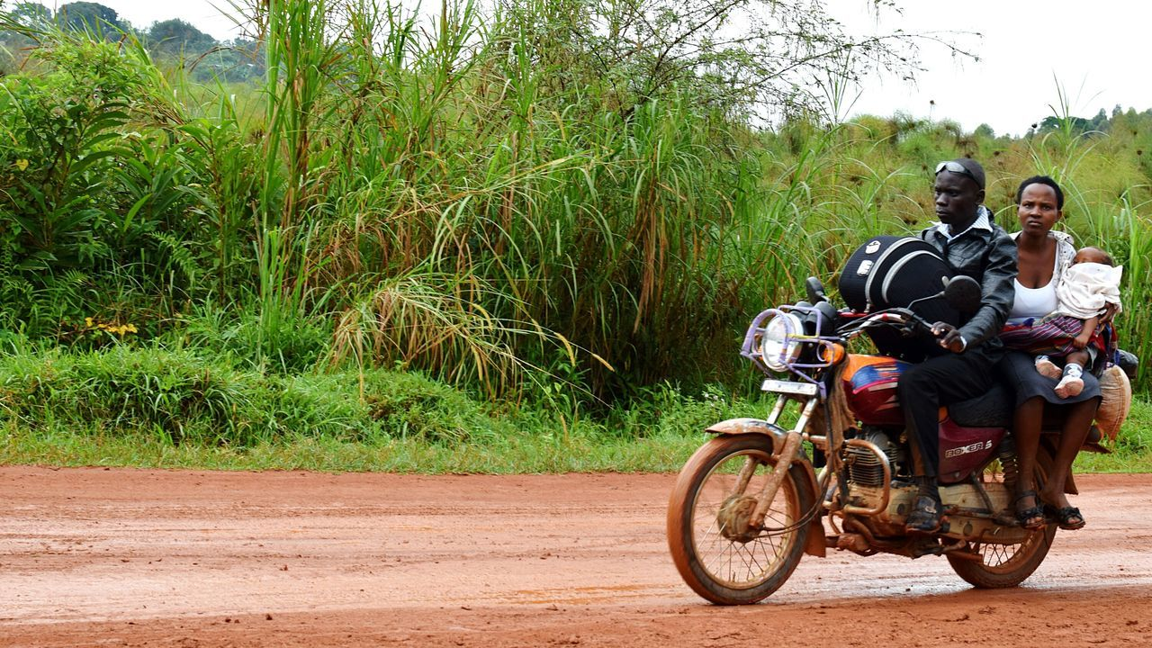 Transportation Adult Men Women Baby Family Day Tree Outdoors Real People People Helmet Sky Motorcycles Mpara Uganda Let's Go. Together.