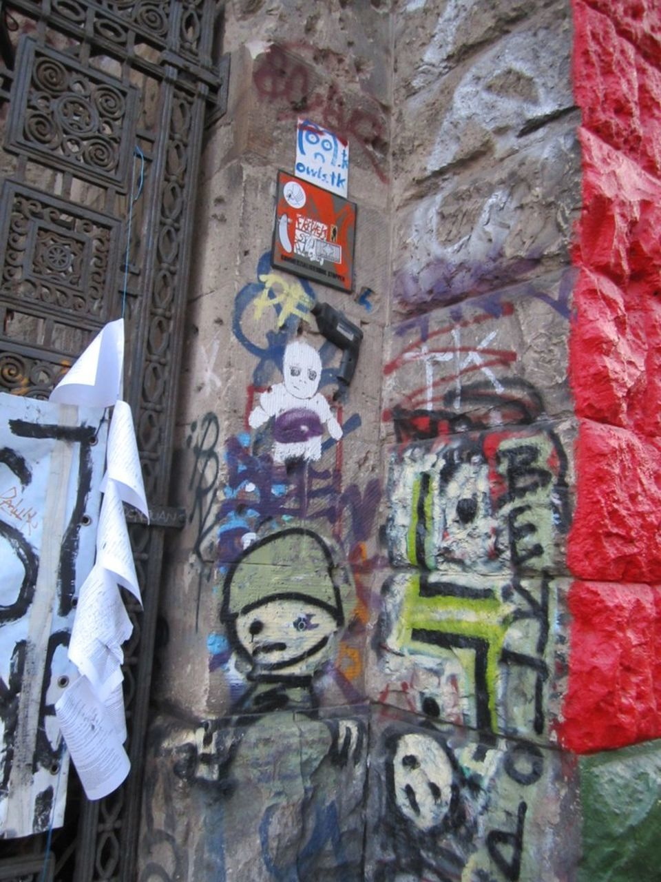human representation, art and craft, text, male likeness, graffiti, no people, day, built structure, architecture, statue, building exterior, outdoors, close-up