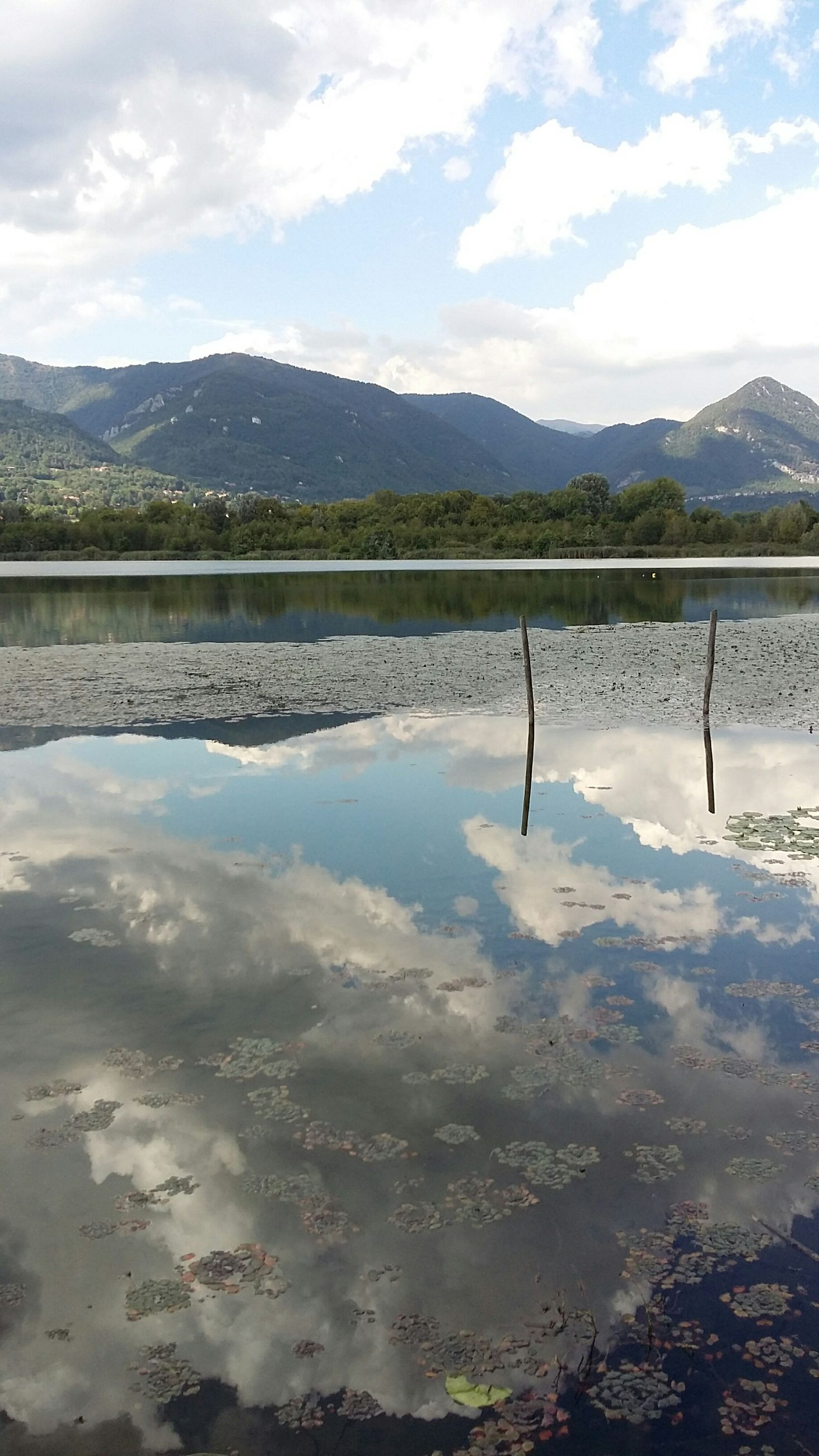 mountain, mountain range, water, lake, sky, tranquil scene, tranquility, scenics, reflection, beauty in nature, cloud - sky, nature, landscape, cloud, non-urban scene, river, idyllic, day, outdoors, cloudy