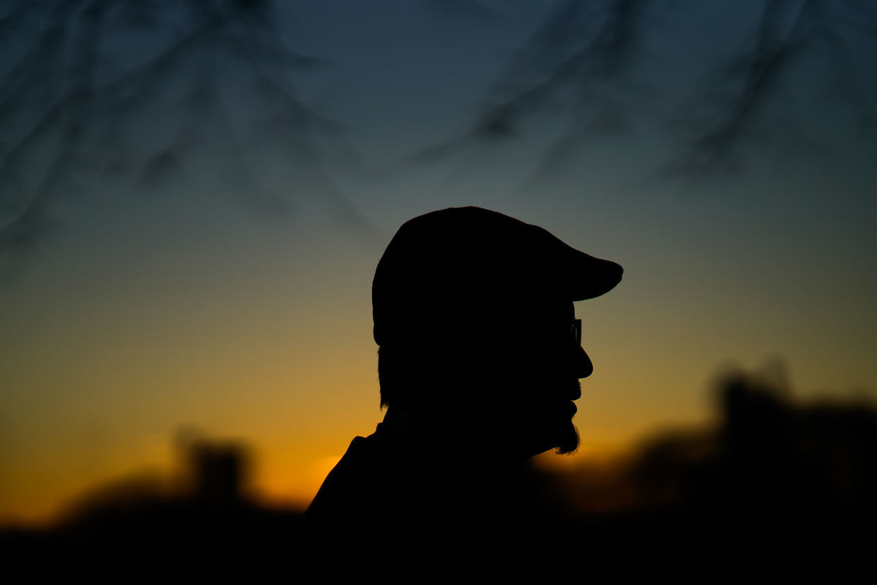 Adult Adults Only Close-up Contemplation Day Flat Cap Headshot Men One Man Only One Person Only Men Outdoors People Real People Real People, Real Lives Silhouette Sky Sunset Young Adult The City Light