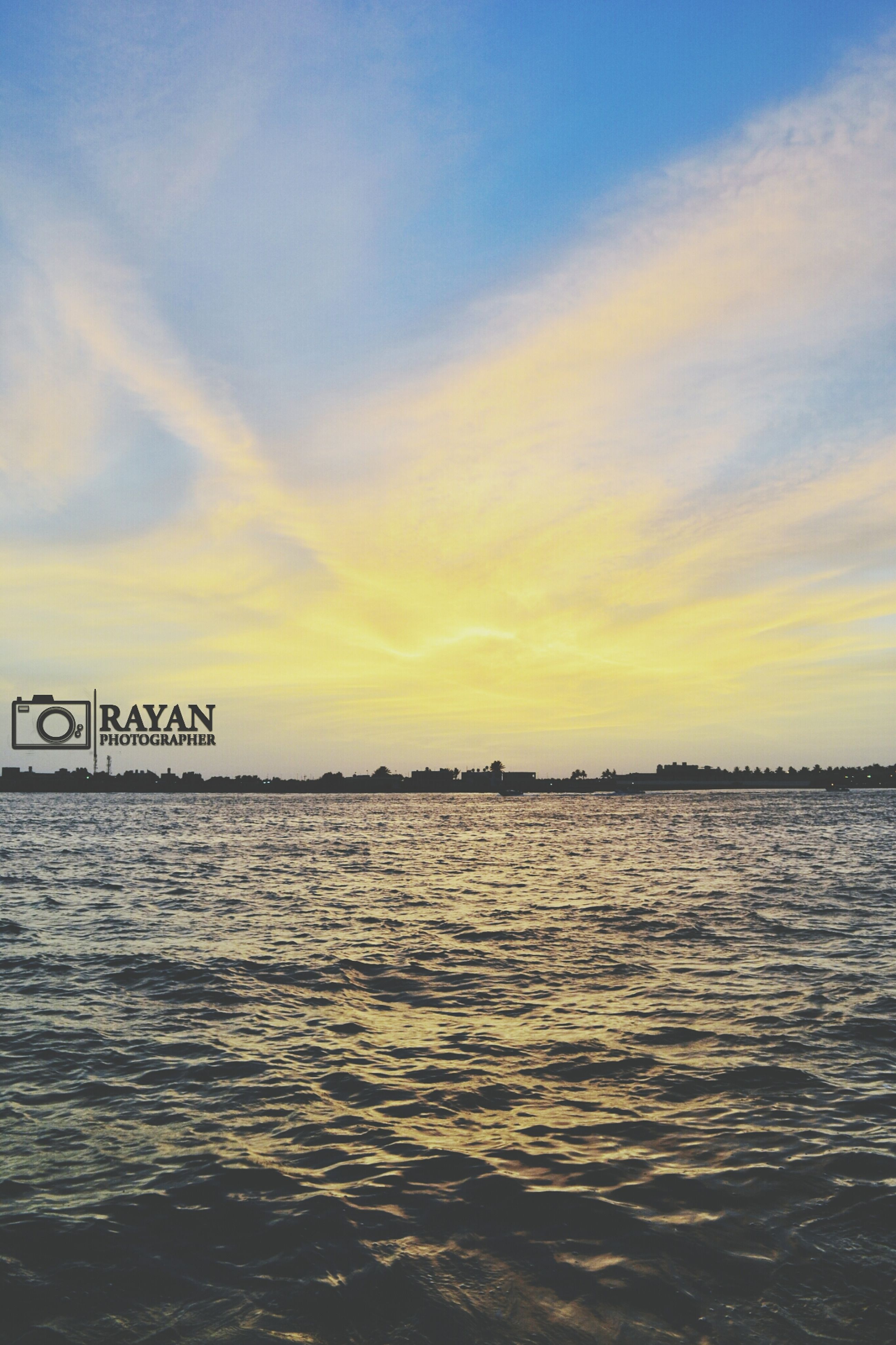 water, sky, sunset, scenics, tranquility, sea, tranquil scene, waterfront, beauty in nature, nature, cloud - sky, rippled, idyllic, outdoors, cloud, no people, text, lake, non-urban scene, calm