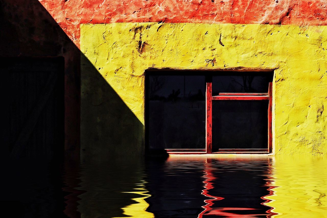 Yellow Built Structure Building Exterior Flood Flooding Flood Disaster Disaster Submerged Yellow And Red Yellow Open Window Homeless Underwater Reflection In Water Wastelands Sunny Day The Great Outdoors - 2017 EyeEm Awards Reflection Water Mellow Yellow Water Reflections Window Frame Window Sill