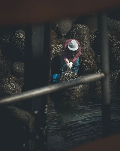 An old woman picking seaside clams Seaside Clams Japan Real People One Person Outdoors Day Water Occupation Working Manual Worker People first eyeem photo EyeEm Ready   EyeEmNewHere
